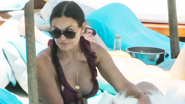 Demi Moore Stuns In A Tiny Striped Bikini As She Jumps For Joy Aboard A Boat In New Photo