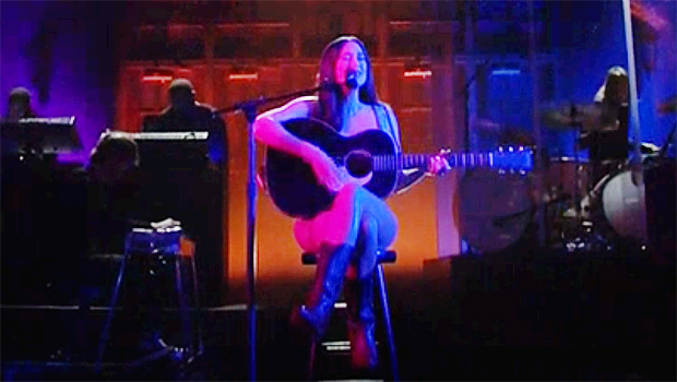 Photo of Kacey Musgraves Appears To Wear Just Her Guitar & Boots For Performance On 'SNL'