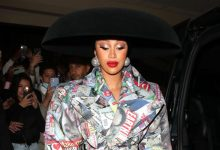 Photo of Cardi B Turns Heads In Tabloid Covered Trench Then Lowcut Black Top & Blazer In Paris With Offset